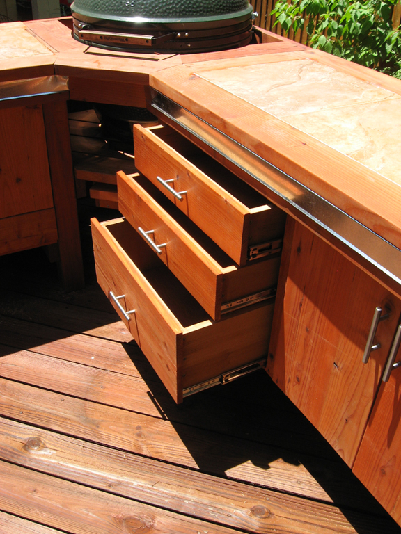Plenty of storage space with drawers and doors in the Big Green Egg BBQ Station.