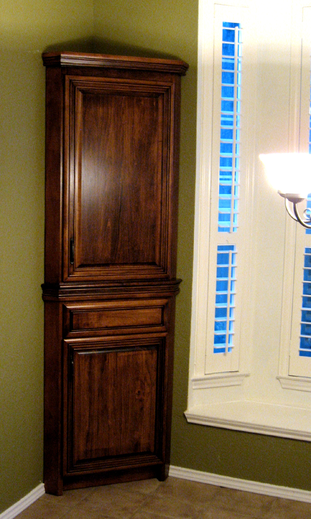 Tall bar counter with cabinet panels Custm corner hutch with rich crown  molding and center rail