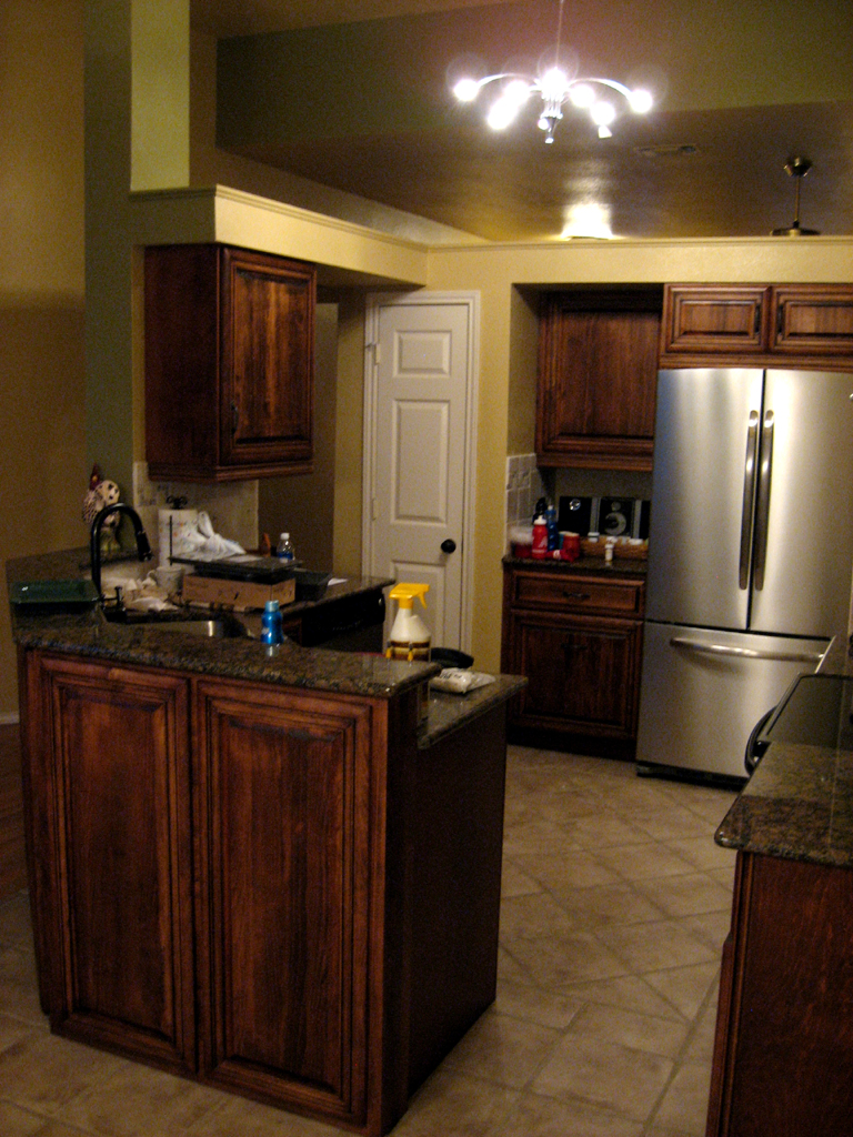 Kitchen cabinets stain glaze - Kitchen And Dining Space Divided By Diagonal Peninsula Island