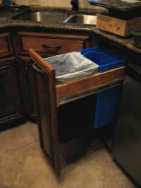 Pull-out Double trash can offers a third compartment to store trash bags.