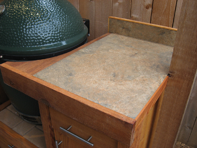 Rugged porcelain tile on BBQ station