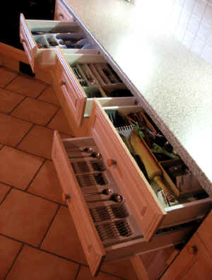 Lots of drawers provide storage and organization for the modern family chef.
