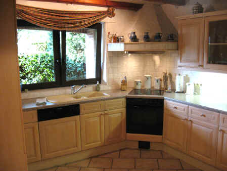 Whitewash Maple kitchen offers lots of space for food prep and clean-up.